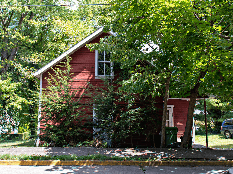 Red house surrounded by trees